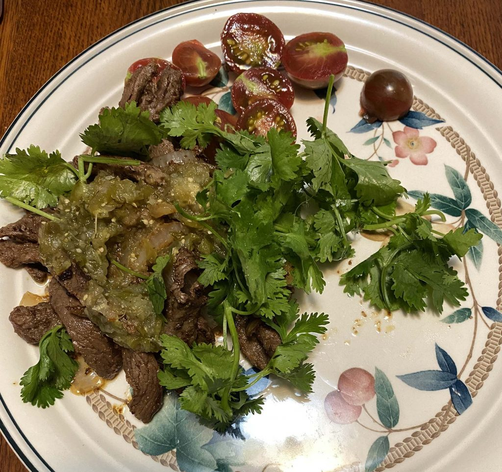 Lunch August 11 2021 - Beef strips sauteed in EVOO with cilantro and 3 purple bumblebee tomatoes